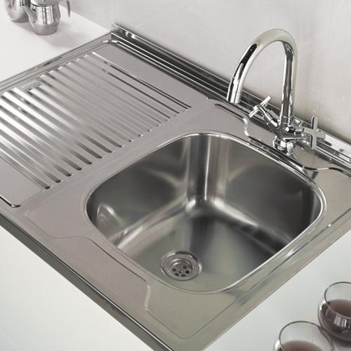Мойка нержавеющая накладная на кухне - фото